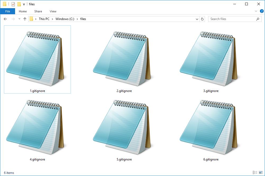 Снимок экрана с несколькими файлами GITIGNORE в Windows 10, которые открываются с помощью блокнота