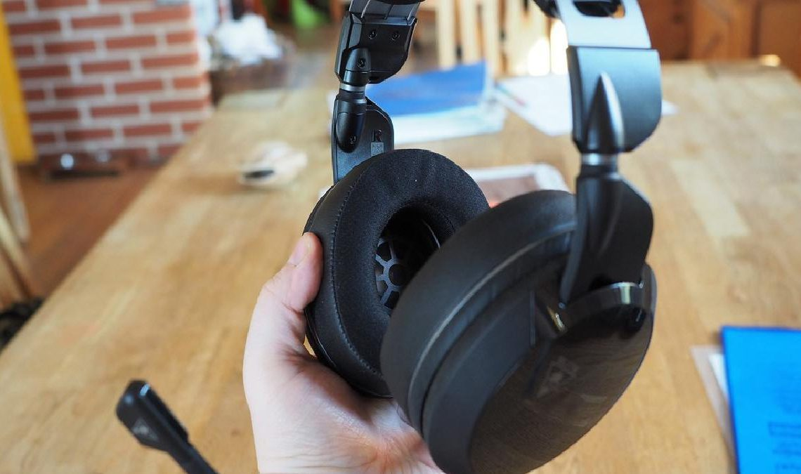 The Turtle Beach Elite Atlas headset it held in an outstretched hand.