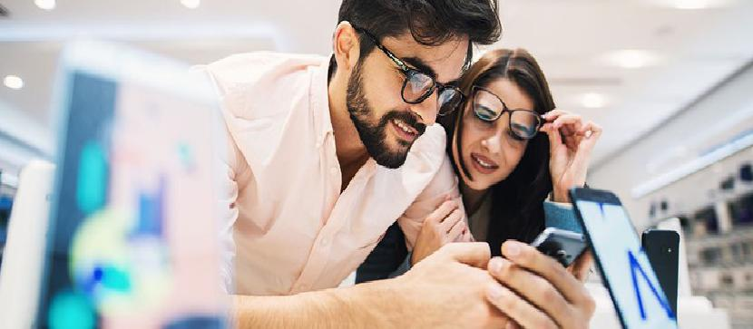 Couple looking at phones